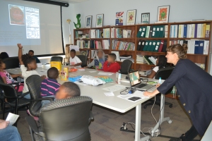 Adrienne works with the youth in her group to better read nutrition labels to find that part that refers to grains.