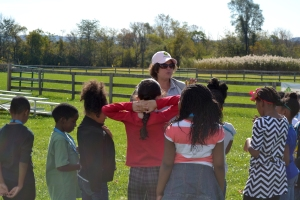 Bronwyn teaching the youth about what farmers do and the many career opportunities in agriculture.