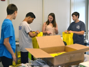 Rishi and some of the teens who helped Santana with goodie bags for the over 500 tour participants.